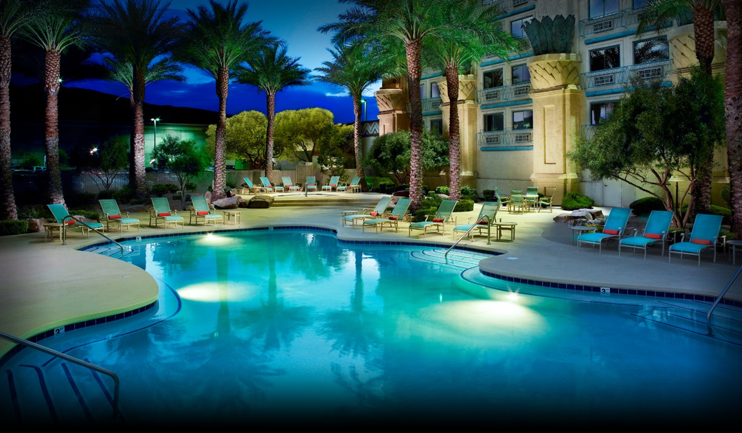 The luxurious pool at Fiesta Henderson Hotel & Casino at dusk