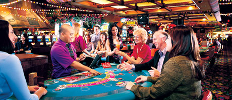 Several guests enjoying a hand of Blackjack